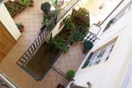 courtyard with flowers - you can visit us